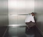 panic-man-in-elevator
